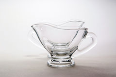 Sauce-boat behind another sauce-boat. On the white background, original still life with glass sauce-boats Stock Photo