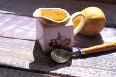 Sauce-boat with pear sauce Royalty Free Stock Photo