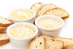 Sauce with cheese and bread. White background Stock Image