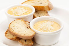 Sauce con queso y pan Foto de archivo libre de regalías