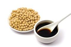 Sauce de soja et haricots Images stock