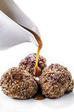 Sauce flows on three peppered meatballs Stock Images