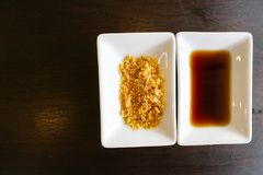 Sauce and fried garlic put on the wood table for use with dimsum in chinese resturant Stock Photo