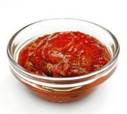 Sauce in a glass container on the white background Royalty Free Stock Image