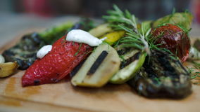 Sauce topping on grilled vegetables stock footage