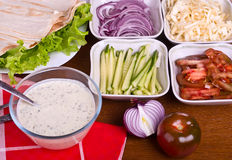 The sauce and Variety of vegetables for cooking shawarma Royalty Free Stock Photography