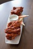 Sauced плита крыла цыпленка Стоковое Изображение