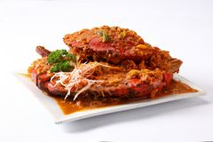 Sauced crab on plate. On white background Stock Images