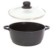 Saucepan. With its top on white background royalty free stock photography