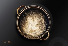Saucepan on black induction cooktop Royalty Free Stock Photography