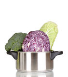 Saucepan with cabbages and broccoli Royalty Free Stock Photos