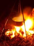 Saucepan on campfires. Fish cooking stock photos