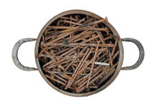 Saucepan full of rusty nails Royalty Free Stock Photography