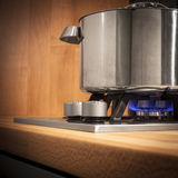 Saucepan. On the gas stove royalty free stock photo