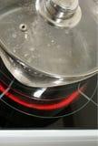 Saucepan on a halogen hob Stock Image