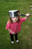 Saucepan on head. Young girl with a saucepan on her head Stock Photos