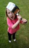 Saucepan on head. Young girl with a saucepan on her head stock image