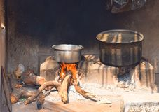 Saucepan on Indian Traditional Hearth with Wooden Stick and Ash Royalty Free Stock Images