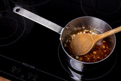 Saucepan with meltet sugar Royalty Free Stock Photos