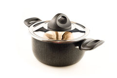 Saucepan with metal lid. On the white Stock Photo