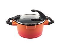 Saucepan. Orange saucepan isolated on white background royalty free stock image