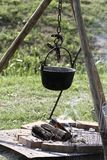 Saucepan over a bonfire Royalty Free Stock Photos