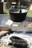 Saucepan over a bonfire Stock Photography