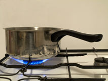 Saucepan on stove Royalty Free Stock Photo
