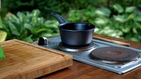 Saucepan on stove in modern kitchen. royalty free stock images