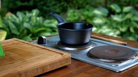 Saucepan on stove in modern kitchen. Saucepan on electric stove in modern kitchen royalty free stock images
