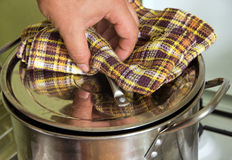 Saucepan to boil. Raise lid from saucepan to boil a kitchen iron pot royalty free stock photography