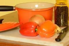 Saucepan and veggies Stock Photos