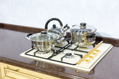 Saucepans on the stove Royalty Free Stock Image