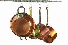 Saucepans two. Saucepans hanging from a rack in a traditional style kitchen Stock Photography