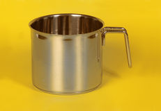 Saucepanstainless steel saucepan with yellow background Stock Image