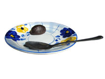 Saucer with chocolate candy and a teaspoon Stock Images