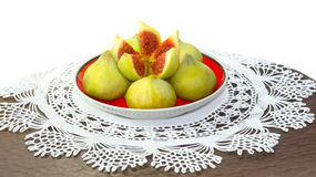 Saucer with fig snack on lacy doily Royalty Free Stock Images
