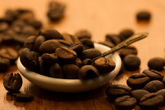 A saucer full of coffee beans Royalty Free Stock Photos