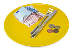 Saucer of money stock photo