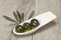 Saucer with olives on a wooden surface royalty free stock photos