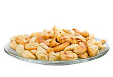 Saucer with roasted cashew nuts isolated on white background Royalty Free Stock Photos