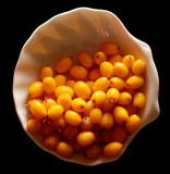 Saucer of sea-buckthorn Stock Photography