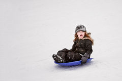 Saucer Sledding Royalty Free Stock Images