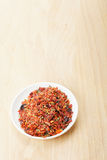 Saucer with spice mixture for rice courses on wood Royalty Free Stock Photo