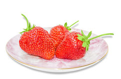 Saucer with strawberries Royalty Free Stock Photo