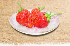 Saucer with strawberries Stock Photo