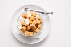 Saucer with sugar. Saucer with white and brown sugar and tongs Stock Image