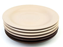 Saucers. Beige and brown saucers against the white background Stock Photo