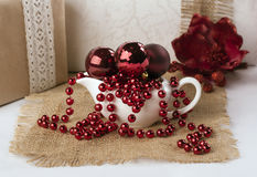 Saucers with Christmas balls and beads Royalty Free Stock Images