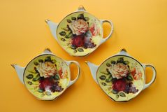 Saucers for tea bags. The decorated plate for tea, in the form of a teapot Royalty Free Stock Images